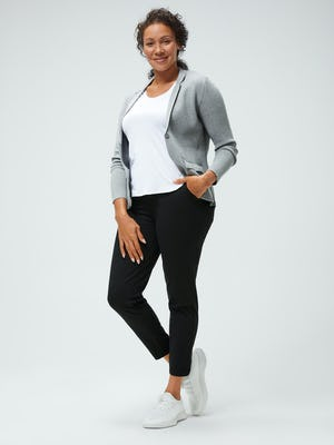 women's white luxe touch tee and light grey atlas knit blazer and black kinetic pull on pant model facing forward with hand in pants pocket