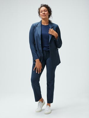 women's azurite heather velocity blazer and pants and navy composite merino tank on model facing forward hands on lapel and leg