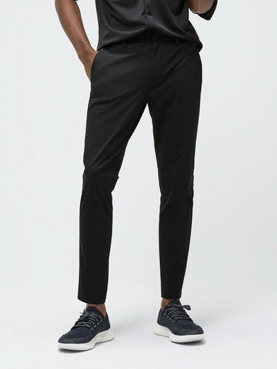 Close up of Men's Black Kinetic Tapered Pant on model