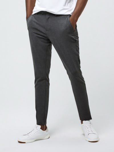 Close up of Men's Graphite Velocity Tapered Pant on model