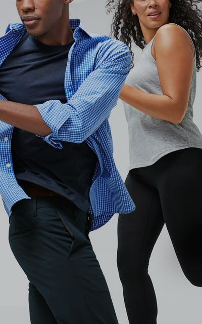 Man and woman wearing composite tee and tank running