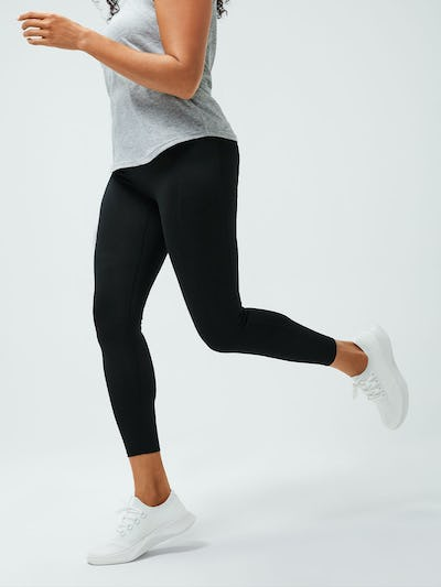 women's black joule legging zoomed shot of model running