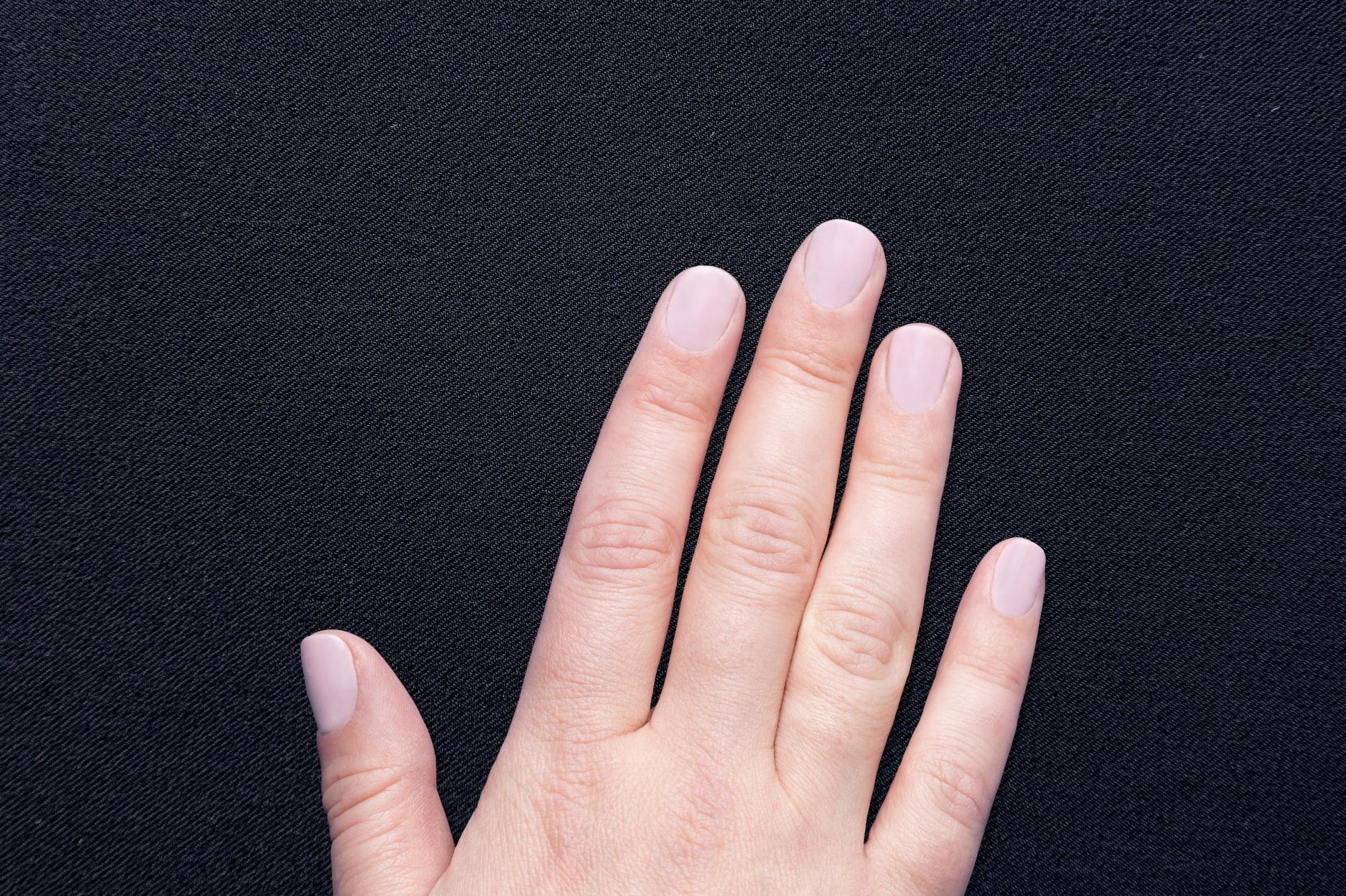Women's hand touching swift drape fabric