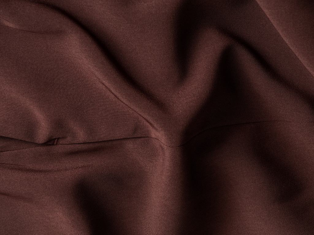 Close up of Deep Ruby Swift Drape fabric