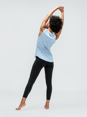 Women's Chambray Blue Composite Active Tank and Black Joule Active Legging on Model facing backwards stretching arms above head