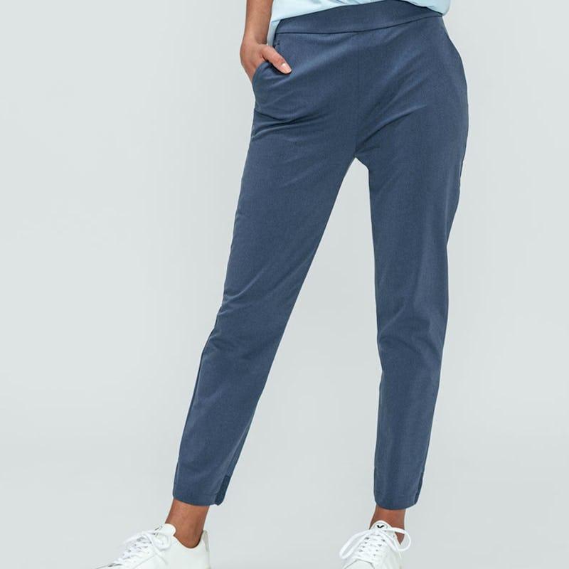 Women's Light Blue Aero Zero Boyfriend Shirt and Women's Slate Blue Kinetic Pull-On Pant zoomed shot on model facing forward hand in pocket