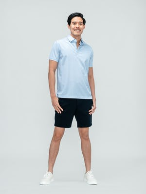 Men's Blue Degree Print Apollo Polo and Navy Kinetic Short on model facing forward with hands in pants pockets