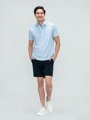 Men's Blue Degree Print Apollo Polo and Navy Kinetic Short on model walking forward with hands in shorts pockets
