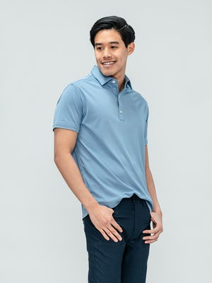Men's Deep Sky Blue Oxford Brushed Apollo Polo on model with hands in pants pockets