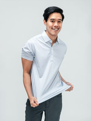 Men's Grey Degree Print Apollo Polo and Medium Grey Kinetic Twill 5-Pocket Pant on model stretching fabric