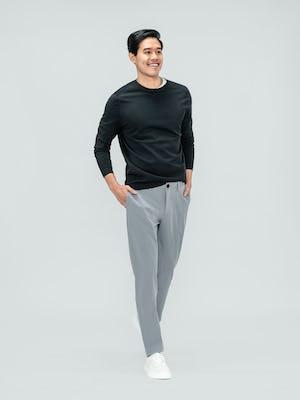 Men's Charcoal Static Atlas Crew Neck Sweater and Men's Light Grey Momentum Chino on model walking forward