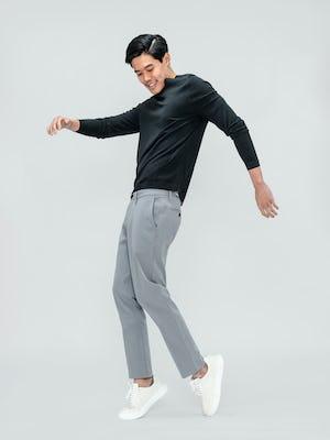 Men's Charcoal Static Atlas Crew Neck Sweater and Men's Light Grey Momentum Chino on model dancing