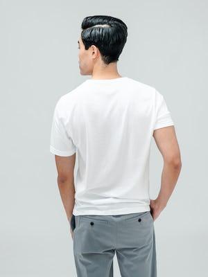 Men's White Atlas V-Neck Tee and Men's Light Grey Momentum Chino on model facing backward