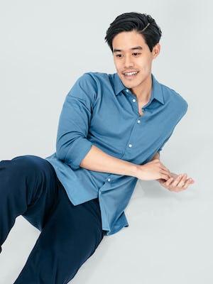 Men's Storm Blue Composite Merino Shirt on model lying on the ground