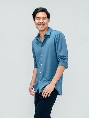 Men's Storm Blue Composite Merino Shirt on model facing left