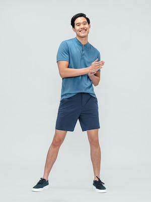 Men's Slate Blue Kinetic Shorts and Men's Storm Blue Composite Merino Short Sleeve Henley on model facing forward