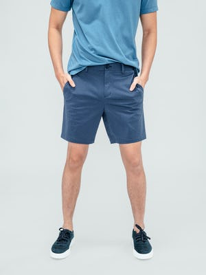 Men's Slate Blue Kinetic Shorts on model with hands in pockets