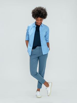 Women's Storm Blue Momentum Chino, Women's Indigo Luxe Touch Tank, and Women's Solid Blue Nylon Aero Shirt on model crossing legs