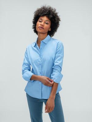 Women's Storm Blue Momentum Chino and Solid Blue Nylon Aero Shirt on model adjusting sleeve