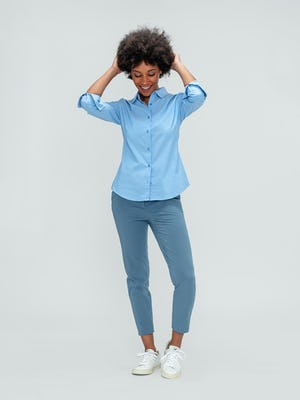 Women's Storm Blue Momentum Chino and Solid Blue Nylon Aero Shirt on model playing with hair