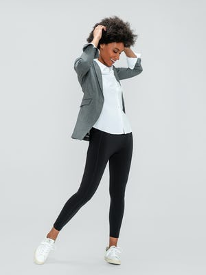 Women's White Aero Zero Shirt, Women's Light Grey Velocity Blazer, and Women's Black Joule Active Legging on model playing with hair