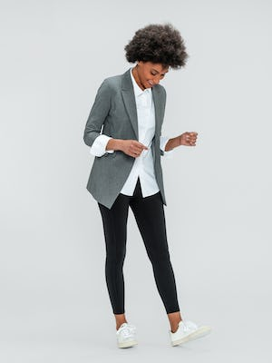 Women's White Aero Zero Shirt, Women's Light Grey Velocity Blazer and Women's Black Joule Active Legging on model walking right