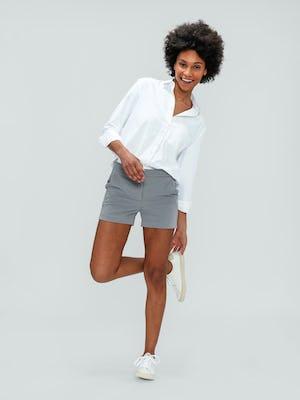 Women's Light Grey Momentum Chino Shorts and White Aero Zero Boyfriend Shirt on model kicking back leg