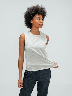 Women's Grey Heather Composite Merino Tank and Women's Grey Glen Plaid Fusion Ankle Pull-On Pant on model stretching shirt