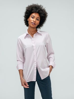 Women's Azurite Heather Velocity Pant and Rose Quartz Juno Blouse on model with hand in pant pocket
