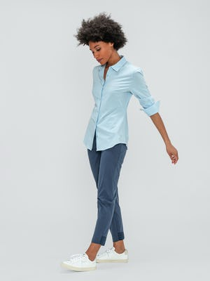 Women's Light Blue Juno Recycled Tailored Shirt and Slate Blue Kinetic Pull-On Pant on model walking left