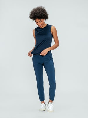 Women's Indigo Luxe Touch Tank and Indigo Heather Velocity Pant on model looking down