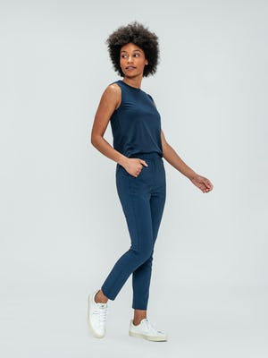 Women's Indigo Luxe Touch Tank and Indigo Heather Velocity Pant on model facing right