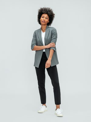 Women's Light Grey Velocity Blazer and Black Kinetic Pull-On Pant on model adjusting sleeve