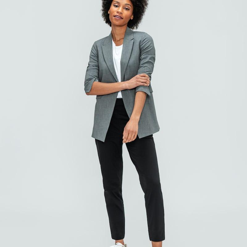 Women's Light Grey Velocity Blazer and Black Kinetic Pull-On Pant on model adjusting sleeve