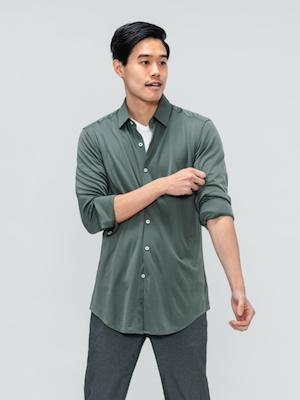 Men's Olive Solid Apollo Shirt on model adjusting sleeve