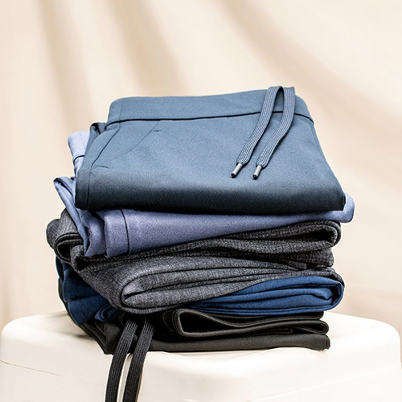 Stack of pants on a white table