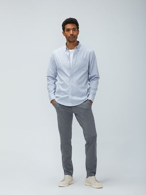 Men's grey heather houndstooth aero button down and slate grey kinetic pant model facing forward