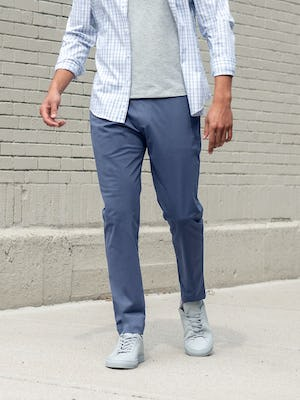 men's indigo heather kinetic jogger and pale grey heather composite merino tee and blue dot matrix aero button down model facing forward with shirt unbuttoned