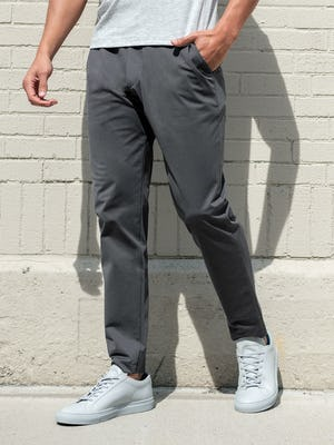 men's charcoal kinetic jogger and pale grey heather composite merino tee on model facing forward with hand in pocket