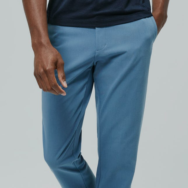 Close up shot of man wearing storm blue momentum chinos