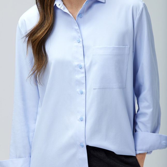 woman wearing a blue aero zero boyfriend blouse