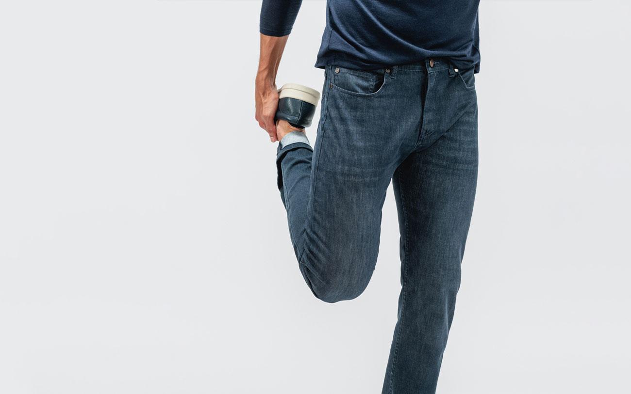 indigo fade chroma denim model doing a leg stretch