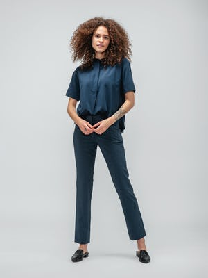 Model wearing navy juno boxy blouse and azurite heather velocity pant facing forward