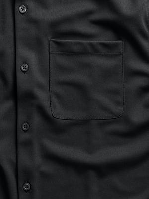 men's black apollo sport shirt zoomed shot of pocket
