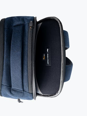 navy aer lunar pack zoomed shot of secure laptop compartment