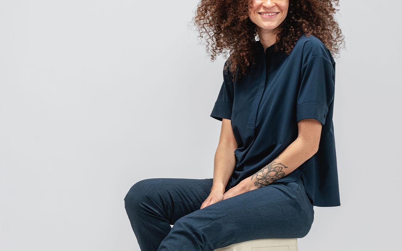 model sitting wearing navy juno boxy blouse