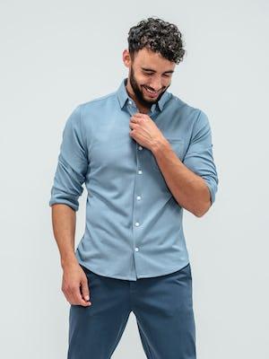 Man facing forward and wearing the slate blue apollo long sleeve raglan shirt