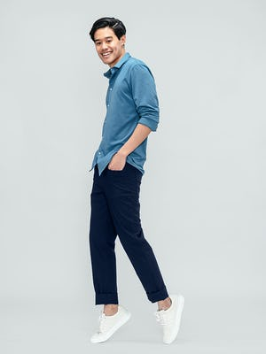 Men's Storm Blue Composite Merino Shirt and Men's Navy Kinetic Twill 5-Pocket Pant on model standing on his toes