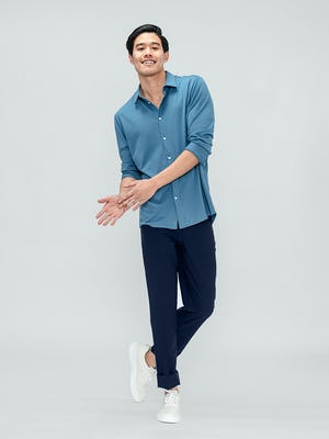 Men's Storm Blue Composite Merino Shirt and Men's Navy Kinetic Twill 5-Pocket Pant on model walking forward