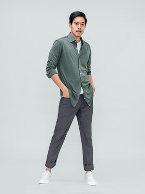 Men's Olive Solid Apollo Shirt and Men's Medium Grey Kinetic Twill 5-Pocket Pant on model with hands in pants pockets